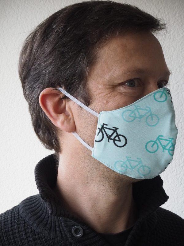 Mundschutz Nasenschutz Maske – mintgrün – mit weißen türkisen und schwarzen Fahrrädern